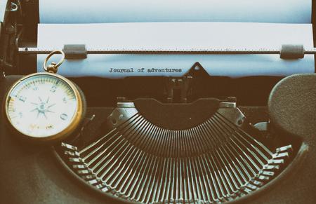 Adventurous writing their stories on an old typewriter Stock Photo