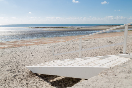 facilitate: Wooden ladders to facilitate access to the beach
