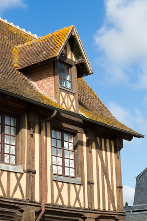 Traditional decorative flowers on around house in Normandy, France