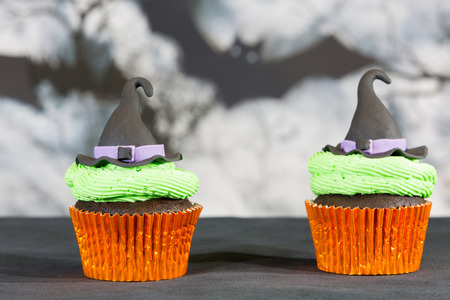 gum paste: Delicious cupcakes decorated with fondant figures for Halloween