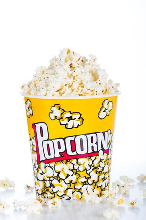 Large pot of popcorn on white background