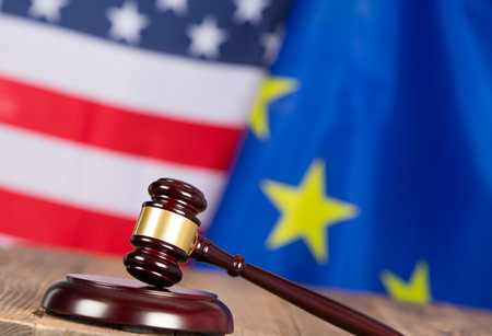Judge hammer with United States flags and European flag Stock Photo