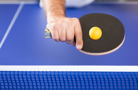 Player in a Ping pong tournament playing a game
