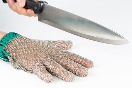 normative: Metal safety mesh glove with a knife