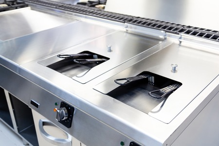 Industrial fryer built in stainless in a kitchen Stock Photo