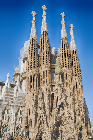 BARCELONA, SPAIN -MAY 11: Sagrada Familia on MAY 11, 2018: La Sagrada Familia - the impressive cathedral designed by architect Gaudi, which is being build since March 19, 1882 and is not finished. Editorial