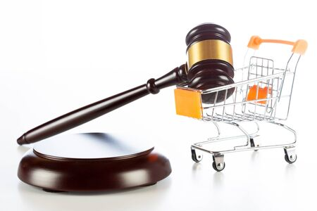 Shopping cart with a gavel of justice