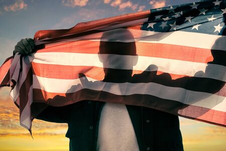 Man with American flag caught with hands
