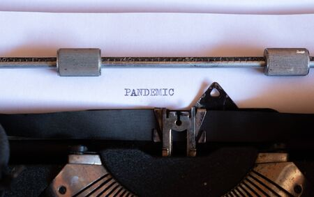 Old typewriter with the word PANDEMIC