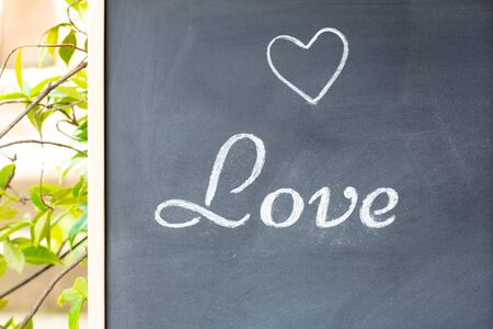 Blackboard with the word love and a drawn heart