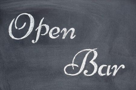 Black chalkboard with the written word Open Bar