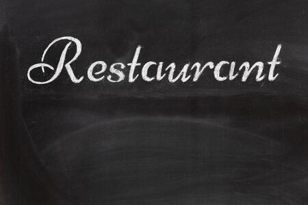 Black chalkboard with the written word Restaurant