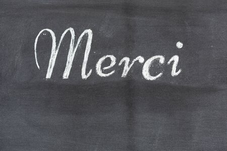 Blackboard with the word Thank you in French