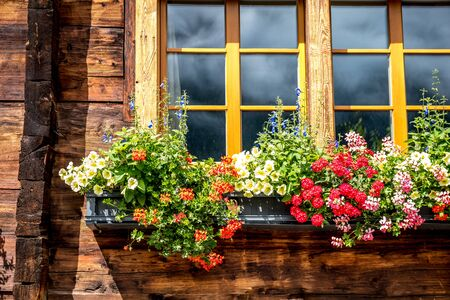 Typical wooden house in Switzerland with its flowers