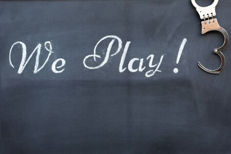 Blackboard with handcuffs to play