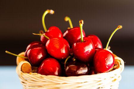 Basket of freshly picked cherries from the tree