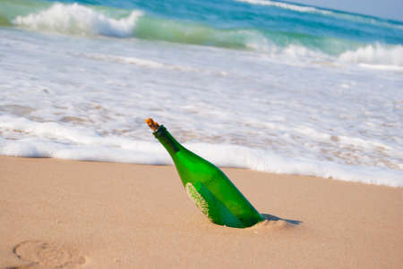 destin: glass bottle on the beach with a sheet of paper inside Stock Photo