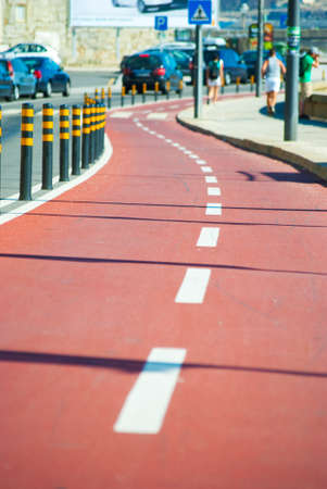 the carriageway: colored bicycle lane with separative enclosure from the main carriageway Stock Photo