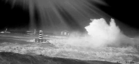 lighthouse on the breakwater and broken wave