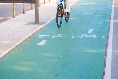 carriageway: colored bicycle lane with separative enclosure from the main carriageway Stock Photo