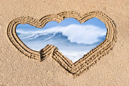 rough sea: crest of a wave in the sand drawn on the heart