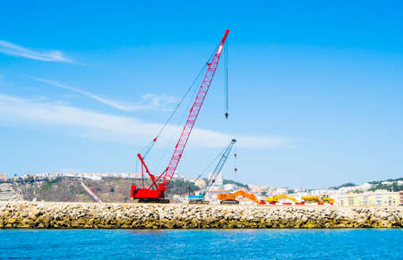 heavy construction: heavy equipment for the construction of a dam
