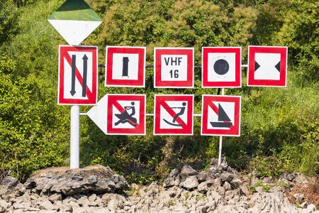Nautical signs that restrict some water sports in that zone of the river.