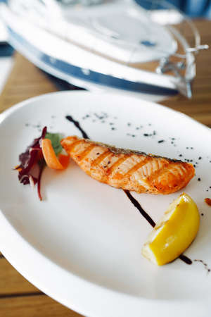delicious grilled red fish on a white plate