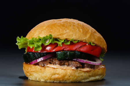 burger on black background closeup