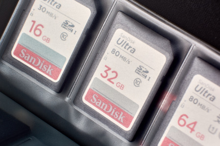 BUENOS AIRES, ARGENTINA - JANUARY 9, 2019: Macro shot showcasing a kit of SD memory cards (16, 32 and 64 GB) placed and organized in a case. Focus on the 32 GB card.