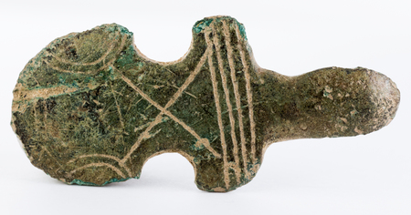 Ancient medieval adornment, possibly part of a buckle. Stock Photo