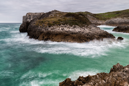 Landscape with long exposure on the coast of Cue. Asturias. Spain. Stock Photo