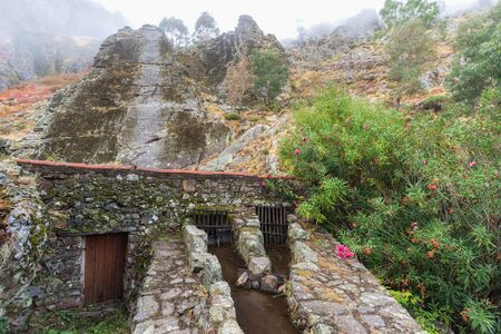 watermills: Landscape with fog, in the foreground a water mill. Geopark of Penha Garcia. Portugal.