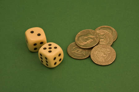 earns: dice and coins on a green rug