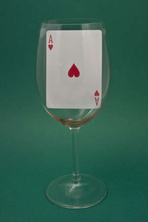 earns: playing card in a glass