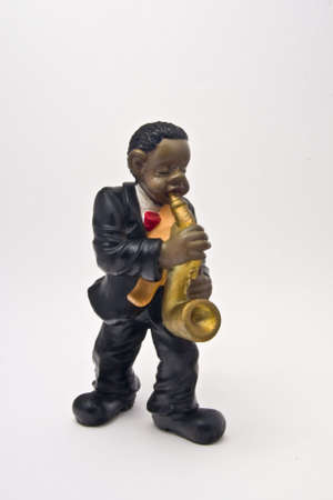 figure of ceramics that represents a musician of jaz touching an instrument Stock Photo - 3842980