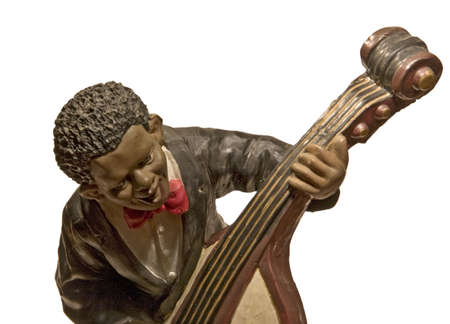 figure of ceramics that represents a musician of jaz touching an instrument Stock Photo - 3842982