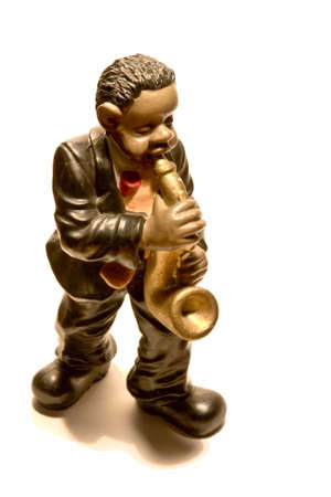 figure of ceramics that represents a musician of jaz touching an instrument Stock Photo - 3842983