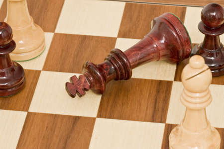 pieces of chess placed on the board photo