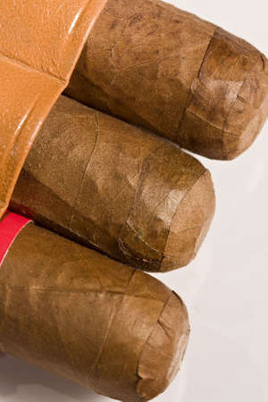 Three pure Havana cigars beginning to show from the tobacco pouch photo