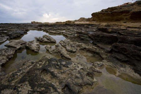 Pools among the rocks by the sea on a winter day Stock Photo - 4180478