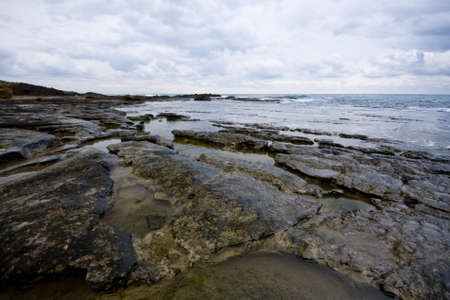 Pools among the rocks by the sea on a winter day Stock Photo - 4180474