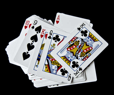 Displays various playing cards on a black background
