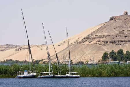 A felucca sails on the Nile in Egypt. Stock Photo - 5835146
