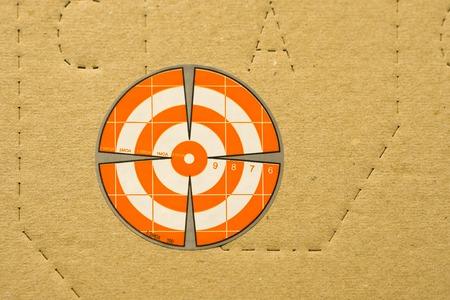 Paper orange target for shooting on IDPA target background
