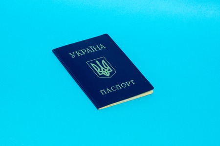 Ukrainian passport on a blue background.