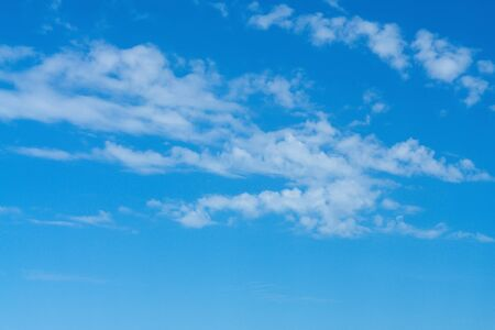 Beautiful cirrus clouds on bright blue sky