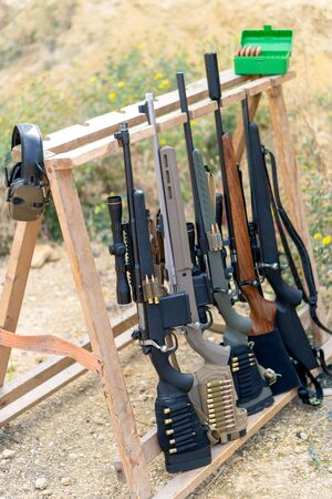 Bolt rifles at the shooting range. Caliber 308, 223 and 22. Concept for a rifle school, shooting courses and safe handling of weapons
