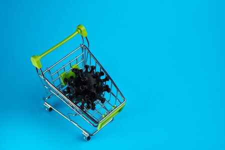 Coronavirus in a shopping cart. Propagation concept COVID-19. Copy space, top view 版權商用圖片