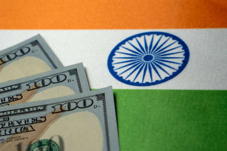 India national flag and the dollar bills. Business and finance concept, soft focus Foto de archivo - 151464163